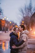 picture of rainy day  - Portrait of young beautiful couple kissing in an autumn rainy day - JPG
