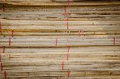 stock photo of lumber  - the Building supplies Stacked wood fence lumber - JPG
