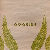 stock photo of paper craft  - Go green text on craft paper - JPG