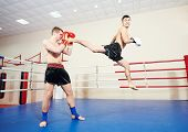 picture of boxing ring  - muai thai sportsman fighting at training boxing ring - JPG