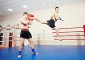 pic of boxing ring  - muai thai sportsman fighting at training boxing ring - JPG