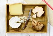 stock photo of trays  - tray different french cheeses with bread and knife - JPG