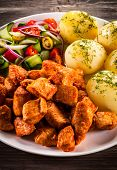 stock photo of boil  - Grilled meat with boiled potatoes and vegetables - JPG