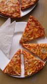 stock photo of hot fresh pizza  - Serving fresh baked and tasty Pizza Quatro formaggi - JPG