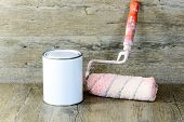 stock photo of paint pot  - roller and paint pot on a wooden table - JPG