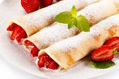 image of crepes  - Crepes with strawberries and cream on white background - JPG