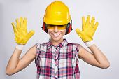 stock photo of shot glasses  - Young Woman with Toolbelt Gloves Level Safety Glasses - JPG