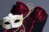 foto of female mask  - sexy female lingerie carnival mask and necklace on grey background - JPG