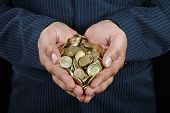 image of indian money  - Business Man Holding Indian Gold Coins in Hands - JPG