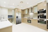 pic of mansion  - Modern kitchen with stainless steel appliances in Australian mansion - JPG