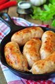 stock photo of fried chicken  - fried chicken sausages with vegetables on a frying pan - JPG