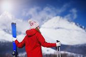 stock photo of nordic skiing  - Young woman skiing outside in sunny winter mountains - JPG