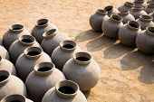 stock photo of rajasthani  - A number of tradtional ceramics or pots drying in the sun near Jodhpur in Rajasthan - JPG