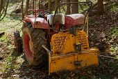 picture of logging truck  - Logging tractor with an anchor winch in the forest - JPG