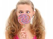 stock photo of teen pony tail  - pretty teenage girl with a lollipop isolated on white - JPG