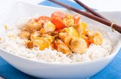picture of paneer  - indian butter chicken with carrots over white rice - JPG