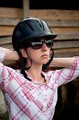 Costa Rican Tourist Putting On Equestrian Helmet poster
