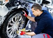 foto of alloy  - Man worker washing car - JPG