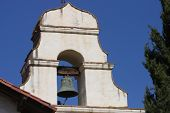 stock photo of blue-bell  - This is an image of an old California mission bell taken on a sunny day against a clear blue sky. ** Note: Soft Focus at 100%, best at smaller sizes - JPG