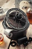 stock photo of reagent  - Developing tank with its film reels photo film rolls cassette vintage camera and chemical reagents on desk - JPG