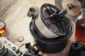 picture of reagent  - Developing tank with its film reels photo film rolls cassette vintage camera and chemical reagents - JPG