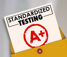 stock photo of mandate  - Standardized Testing words on a report card graded or scored A Plus to illustrate results of manadated - JPG
