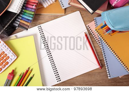 Busy Student\'s Desk With Blank Open Notebook