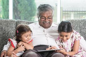 stock photo of grandparent child  - Modern technology concept - JPG