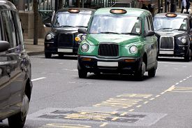 picture of hackney  - Four London Taxi Cabs in Canary Wharf - JPG