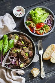 foto of liver fry  - fried chicken liver and grilled vegetables  - JPG