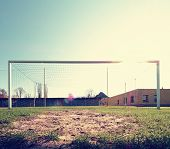 Hang Bended Blue Yellow Soccer Nets, Soccer Football Net. Grass On Football Playground In The Backgr poster