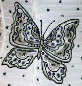 Butterfly pattern beadwork on a dress