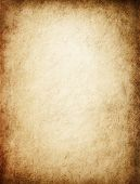 Antique yellowish parchment paper grungy background texture