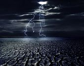 Cracked land and the lightning bolts