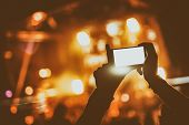 Постер, плакат: Hand With A Smartphone Records Live Music Festival And Taking Photo