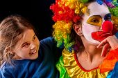 Single parent family. Tired mom after work as clown on birthday on dark background. Mother angry chi poster