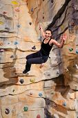 picture of climbing wall  - active young woman on rock wall in sport centre - JPG