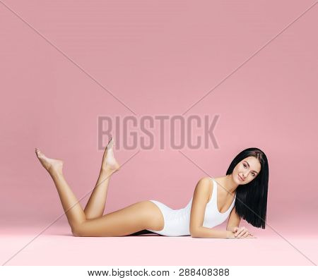 poster of Fit And Sporty Girl In Underwear. Beautiful And Healthy Woman Posing In White Swimsuit. Slim Body. S