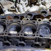 The Cylinder Block Of The Four-cylinder Engine. Disassembled Motor Vehicle For Repair. Parts In Engi poster