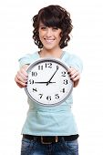 stock photo of young women  - smiley young woman with clock - JPG