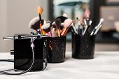 Beauty And Fashion. Makeup Tools And Brushes On Artist Workplace. Makeup Products Set. Beauty Salon  poster