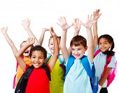 image of laugh out loud  - Five happy children with their hands up - JPG