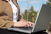 Woman Working Outdoors On Laptop Computer