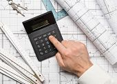Architect Using Calculator On Architectural Blueprint House Building Plan With Pencil, Ruler, Compas poster