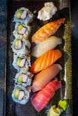 Top Down View Of Savory Japanese Nigiri Sushi With Tuna Toro, Tuna Ahi, Salmon Sake, Yellowtail Hama poster