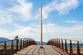 Symmetric View Of Old Bridge By The Sea Clear Sky Daylight Symmetry poster