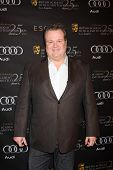 LOS ANGELES - JAN 14:  Eric Stonestreet arrives at  the BAFTA Award Season Tea Party 2012 at Four Se