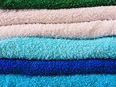 Stack Of Colorful Bath Towels  On White Background.pile Of Rainbow Colored Towels Isolated.top View. poster