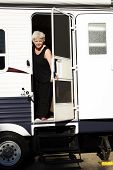 Woman Opening Door Of Trailer