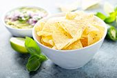 Corn Chips In A Big Bowl With Guacamole poster